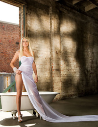 Tenaya is a dream - a mirage-like ghost town beauty that drops her long, flowing dress to take a luxurious outdoor bath!