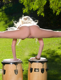 Madison Scott wants you to beat her bongos! She's even going to treat you to a delightful nude drum solo of her own complete with crazy wild spin