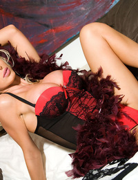 Nikki Benz teasingly hides and then flashes her luscious breasts and even prettier pussy behind her long feathered boa!