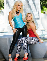 Kayden Kross and Jaclyn Case strip off each other's slutty, skin-tight capris and tube tops by a public water fountain and get down to some wet,