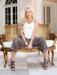 Eden Adams drapes her perfect nude curves and hot blonde mane all over a small patio couch during this Penthouse glamour photo shoot!